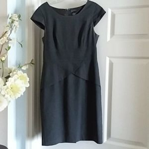 Flattering gray form-fitting business dress.